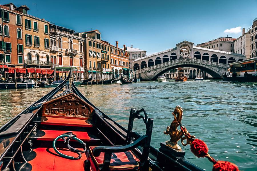 A gondola in a canal lined with colourful buildings