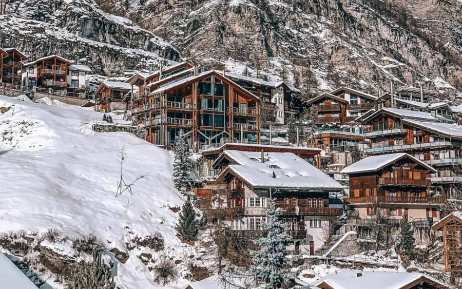 Wooden houses covered in snow