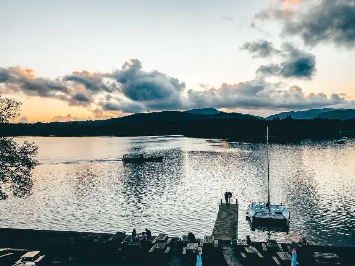 Boat sailing at sunset on lake Windemere
