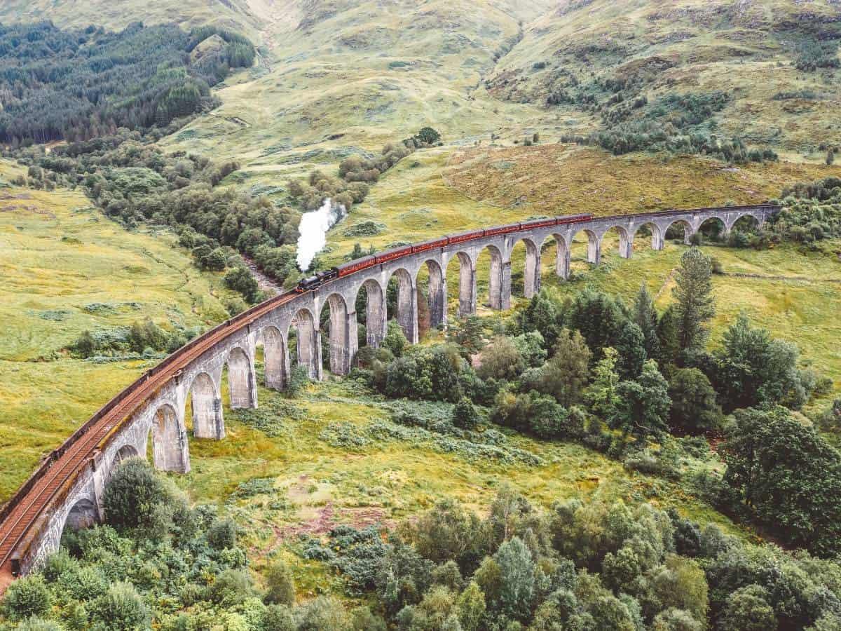 A steam train crossing the Glenfinnan Viaduct