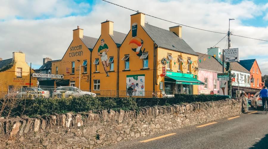 The yellow building of Sneem Tavern in Sneem, Ireland