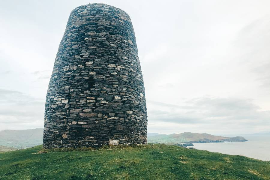 Eask tower on top of a hill over looking dingle bay