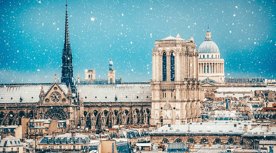 A view of the Notre Dame in Paris covered in snow