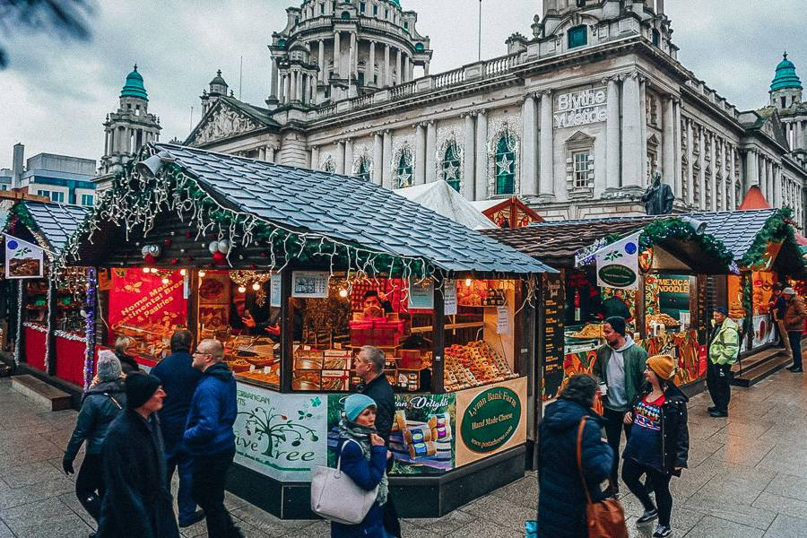 A christmas market stall in front of the Belfast town hall