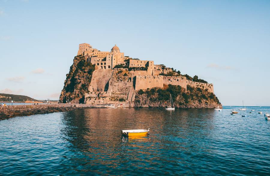 The island Ischia with boats floating on the water