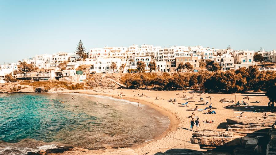 White buildings lining the beach in Paros