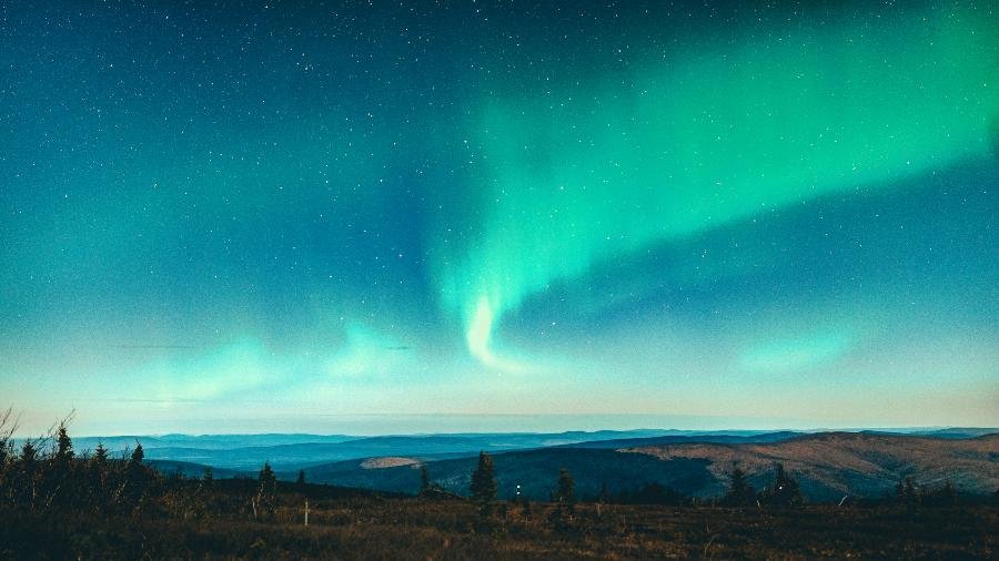 Northern Lights over rolling fields