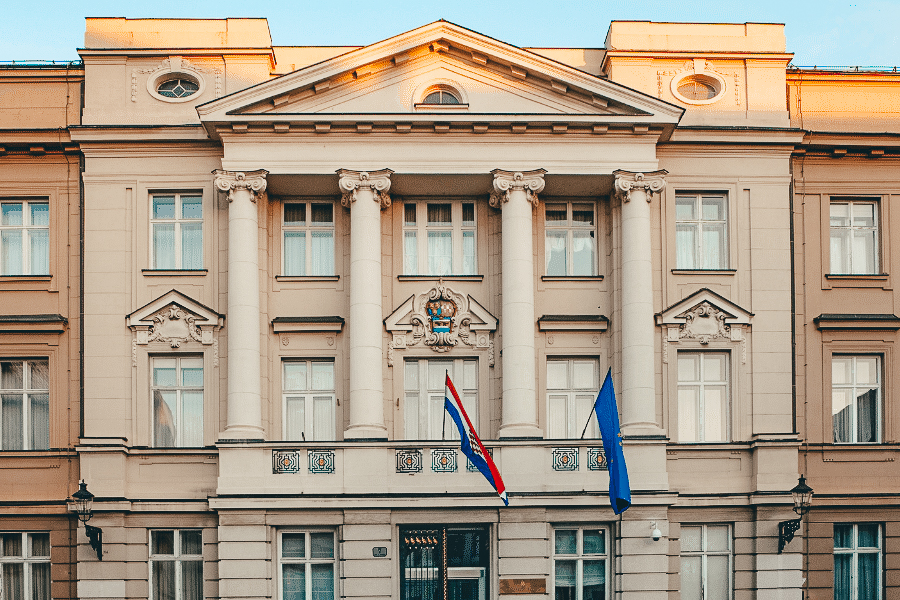 Zagreb parliament building with the Croatian flags flying out the front