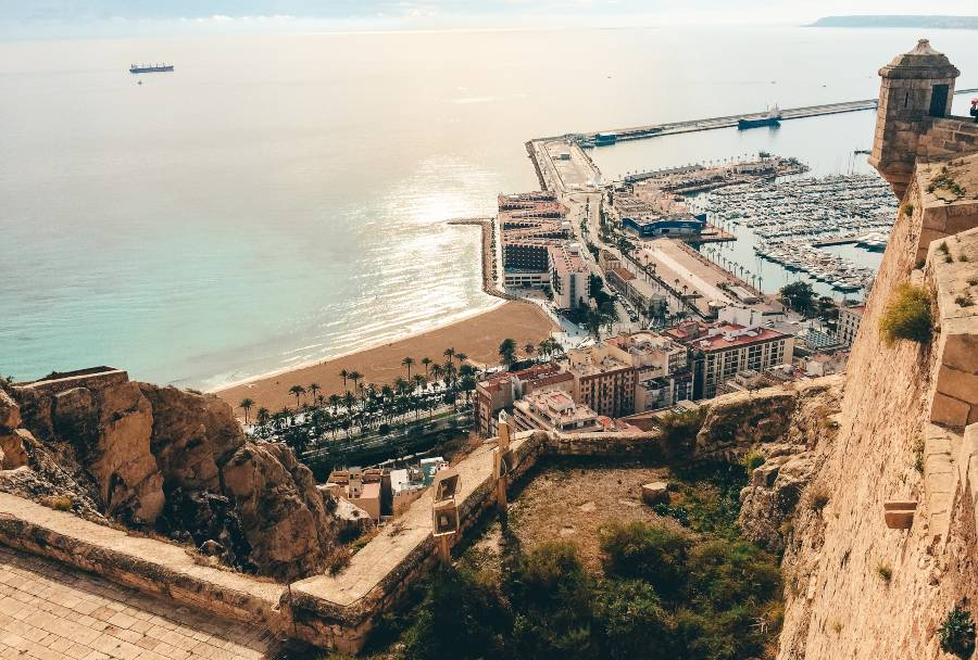 A view over the ancient walls over the town and the harbour in Alicante, Spain