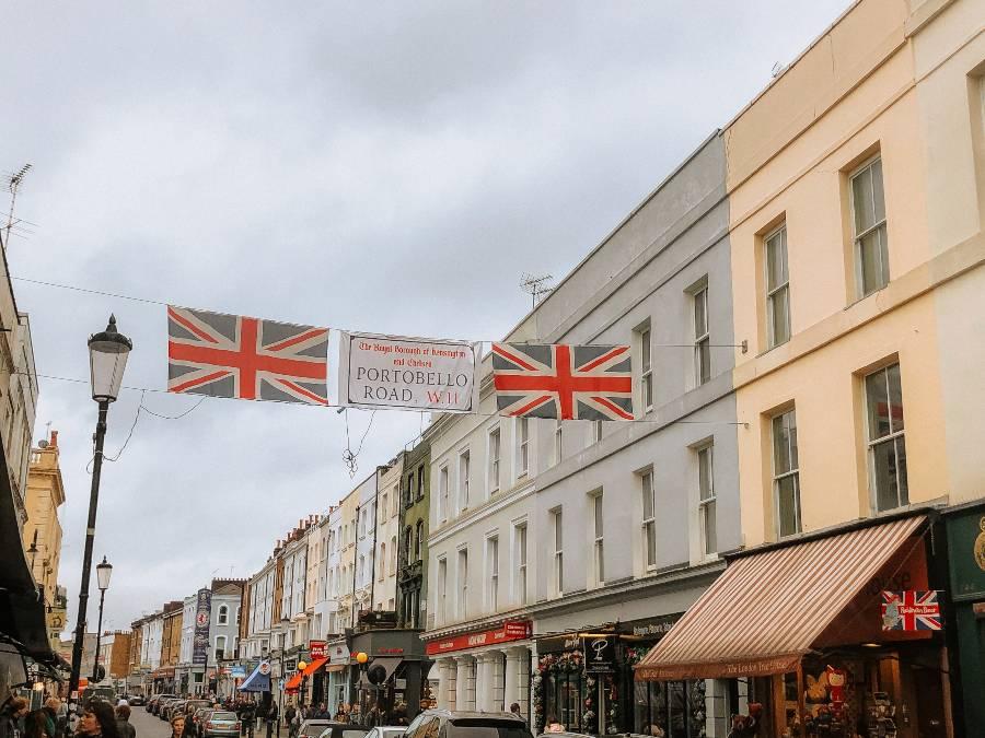 The Portobello Road flag next to two Union Jack Flags on Portobello Road